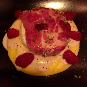 Polenta with a huge wedge of grilled cheese, very tasty Italian ham, and raspberries. So much cheese.